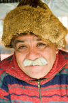 Punta Arenas, Chile: old Chilean man with mustache and wearing a beaver hat in a market stall - photo by D.Smith