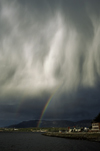 Puerto Natales, Magallanes region, Chile: double rainbow and falling rain � Patagonian sky - photo by C.Lovell