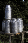 Chiloé island, Los Lagos Region, Chile: milk cans await pick up on a country - dairy industry - photo by C.Lovell