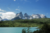 Torres del Paine National Park, Magallanes region, Chile: Cuernos del Paine - the Horns of Paine from Lake Nordenskj�ld � ducks in flight - Chilean Patagonia - photo by C.Lovell