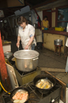 Puerto Montt, Llanquihue Province, Los Lagos Region, Chile: preparing food at the Fish Market - frying and boiling - photo by D.Smith