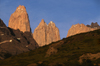 Torres del Paine National Park, Magallanes region, Chile: sunrise on the Towers of Paine - vertical granite pillars - Chilean Patagonia - photo by C.Lovell