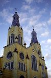 Castro, Chiloé island, Los Lagos Region, Chile: twin church steeples of San Francisco de Castro church built in 1906 – colourful wooden church by architect Eduardo Provasoli - Unesco world heritage site - Iglesia Apóstol Santiago - photo by C.Lovell