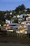 Castro, Chiloé island, Los Lagos Region, Chile: 'palafitos', picturesque shingled houses on stilts – low tide on the fjord - photo by C.Lovell