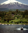 Araucanía Region, Chile - Lake Villarica: boat and view of Villarica volcano, Villarica NP - photo by Y.Baby