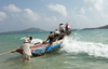China - Hainan Island: launching fishing Boat  (photo by G.Friedman)