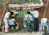 China - Hainan Island: outdoor haircut - low-overhead barbershop  (photo by G.Friedman)
