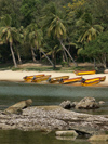 China - Hainan Island: beach - boats, rocks and palmtrees (photo by G.Friedman)