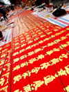 China - Hainan Island: red banners for sale - Chinese New year - Spring Festival (photo by G.Friedman)