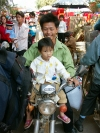 China - Hainan Island: father and daughter on motorcycle (photo by G.Friedman)