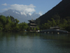 Lijiang, Yunnan Province, China: Dragon Park - pond, pagoda, bridge and mountains - photo by M.Samper