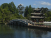 Lijiang, Yunnan Province, China: Dragon Park - pagoda and stone bridge by the water - photo by M.Samper