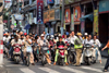 Shanghai, China: crowd of bicycles and motorbikes at a traffic light - photo by Y.Xu