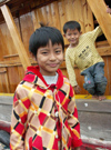 China - Hainan Island: brothers on boat (photo by G.Friedman)