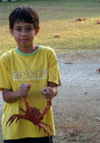 36 Christmas Island: Red Crab held by Malay boy (photo by B.Cain)