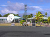 Cocos islands / Keeling islands / XKK - West Island - atoll: airport facilities - radio mast and satellite dish - communications - photo by Air West Coast