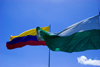 Medellín, Colombia: flags of Medellín and the Colombian Republic against a blue sky - photo by E.Estrada