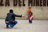 Zipaquir�, department of Cundinamarca, Colombia: a father offers his daughter a hug - Miner's square - Plaza del Minero - photo by E.Estrada