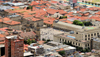 Bogota, Colombia: old town from above - red roofs and Plaza de Bolivar - Palacio Li�vano, Palacio de Justicia, Cathedral and Capitolio - La Candelaria - photo by M.Torres