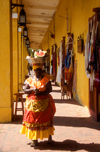 Colombia - Cartagena: colonnade and market - woman with fruit over her head, local Carmen Miranda - photo by D.Forman