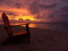 Cook Islands - Rarotonga island: chair overlooking sunset at Black Rock beach - photo by B.Goode