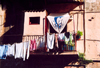 Corsica - Bastia: WC on the balcony - hanging toilet - laundry drying - photo by M.Torres