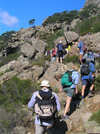 Corsica -  Bavella (Corse du Sud): hikers on a hilside - climbing (photo by J.Kaman)