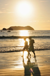 Manuel António, Puntarenas province, Costa Rica: couple in a romantic walk - sunset - Pacific ocean, Las Gemelas and Isla Larga - photo by M.Torres