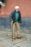 Croatia - Cakovec: elderly man with a cane - photo by P.Gustafson