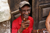 Havana / La Habana / HAV, Cuba: friendly domino player - photo by A.Ferrari