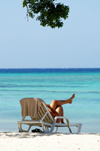 Cuba - Guardalavaca - Relaxing by beach with tree at top - Every travel brochure can use this image. It represents travel, relaxation, and a leisurely lifestyle - photo by G.Friedman
