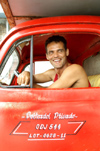 Cuba - Holguín - driver of a classic 1950's era Ford truck poses for the camera - photo by G.Friedman