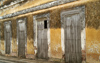 Cuba - Holguín - wall and four doors - photo by G.Friedman
