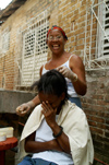 Cuba - Holguín - laughing during haircut - photo by G.Friedman