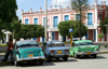 Cuba - Holguín - three old cars - photo by G.Friedman