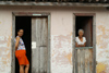 Cuba - Holguín - two women, two doors - photo by G.Friedman