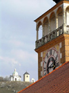 Czech Republic - Mikulov / Nikolsburg (Southern Moravia - Breclav district): clock of St Wenceslas Church - Holy Hill in the background  - photo by J.Kaman