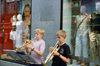 Copenhagen, Denmark: two boys playing trumpets on the street - music stand with sheet music - clothes shop windows - photo by K.Gapys