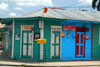 Higüey, Dominican Republic: wooden building with strong colours - photo by M.Torres