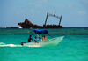 Punta Cana, Dominican Republic: sea taxi and the Astron Shipwreck - Arena Gorda Beach - photo by M.Torres