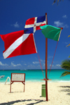 Punta Cana, Dominican Republic: beach flag pole - Dominican, green and diver down flags - Arena Gorda Beach - photo by M.Torres