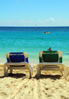 Punta Cana, Dominican Republic: two lounge chairs and the Ocean - Arena Gorda Beach - photo by M.Torres