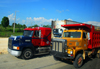 La Romana, Dominican Republic: American trucks head to San Domingo - Mack and International - photo by M.Torres