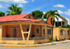 Dajab�n, Dominican Republic: street corner - lively colors of Creole architecture - Cibao region - photo by M.Torres