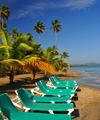 R�o San Juan, Mar�a Trinidad S�nchez province, Dominican republic: beach chairs and young coconut trees - photo by M.Torres