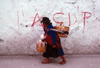 Ecuador - Quito: Indian woman with child and baskets  - street with CDP graffiti - photo by J.Fekete