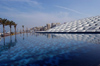 Egypt - Alexandria: the library - Bibliotheca Alexandrina - from the pond - design by Snohetta (photo by John Wreford)