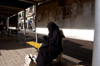 Egypt - Alexandria:  muslim woman texting on a cell  phone (photo by John Wreford)