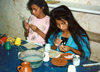 El Salvador - Ilobasco: girls painting small clay souvenirs - photo by G.Frysinger
