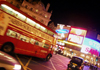 London: Piccadilly circus - Routemaster bus at night - photo by K.White